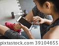 Young asian woman using smartphone in gym 39104655