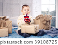 little funny playful boy a child sits on a bed on 39108725