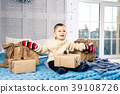 little funny playful boy a child sits on a bed on 39108726