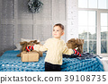 little funny playful boy a child sits on a bed on 39108735