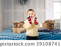 little funny playful boy a child sits on a bed on 39108741