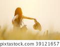 Joyful woman in barley field in summer sunset 39121657