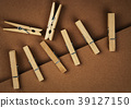 wooden pins on brown paper 39127150