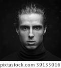 Handsome man raw portrait at dark background 39135016