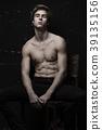 Young Handsome man portrait at dark background 39135156