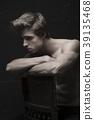 Young Handsome man portrait at dark background 39135468