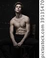 Young Handsome man portrait at dark background 39135470