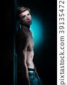 Young Handsome man portrait at dark background 39135472