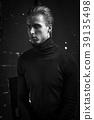 Young Handsome man portrait at dark background 39135498