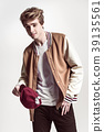Fashionable, Handsome man poses in fancy clothes 39135561