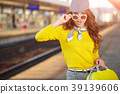 Pretty young woman boarding a train 39139606