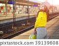Pretty young woman boarding a train 39139608