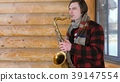 saxophonist plays the saxophone, in winter 39147554