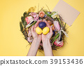 Easter card. Painted Easter eggs in nest on yellow 39153436