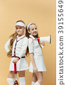 Portrait of two girls as tennis players holding 39155649