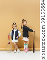 Portrait of two girls as tennis players holding 39155664