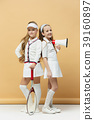 Portrait of two girls as tennis players holding 39160897