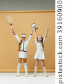 Portrait of two girls as tennis players holding 39160900