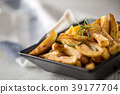 Homemade potato fries with salt and rosemary. 39177704