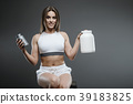 girl with supplement whey protein shake powder 39183825