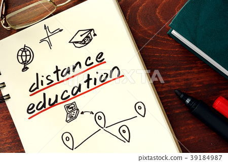 Words distance education written in the notepad. 39184987
