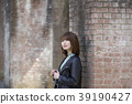 Young woman on the back of the hydrographic tower at Nanzenji Temple in Sakyo Ward, Kyoto City, Kyoto Prefecture 39190427