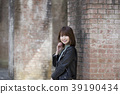 A smiling young woman behind a water channel in Nanzenji Temple in Sakyo Ward, Kyoto City, Kyoto Prefecture 39190434
