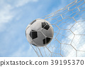 Soccer ball on goal with net and sky background 39195370