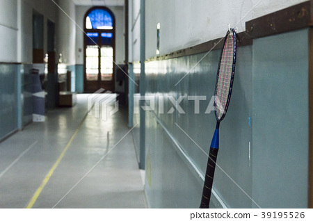 Tennis racket hanging from the nail 39195526