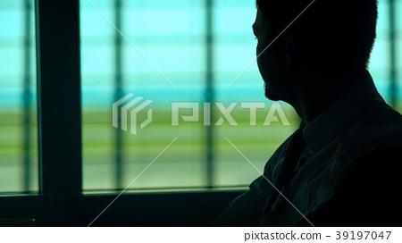Pensive man having cup of coffee in waiting room 39197047