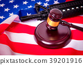 Gavel with gun on background of USA flag 39201916