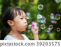 Asian girl play a bubble in nature, this picture c 39203575