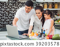 Mother, father and daughter cooking salad menu for 39203578