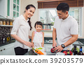 father, mother and daughter cooking for dinner tog 39203579