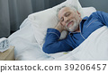 Senior man smiling while asleep in the morning 39206457