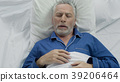 Aged male loudly snoring and puffing in bed 39206464