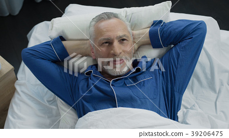 Man basking in bed rejoicing at new orthopedic 39206475