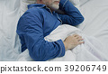 Old man sleeping in bed in the morning, recovery 39206749