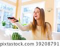 Young woman watching TV 39208791