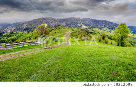 country road through rural area in mountains 39212098