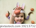 a little girl holding ann Easter egg 39213732