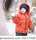 Infant boy and mother while snows 39217486
