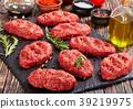 salisbury beef steak on black stone plate 39219975