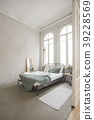 Interior of white and gray cozy bedroom 39228569