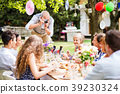 Family celebration or a garden party outside in 39230324