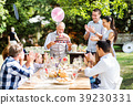 Family celebration or a garden party outside in 39230331