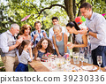 Family celebration or a garden party outside in 39230336
