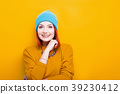 Smiling woman with a blue hat smiling and looking 39230412