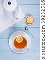 White kettle and the cup of tea with lemon 39232516