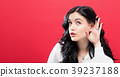 Young woman hearing something 39237188